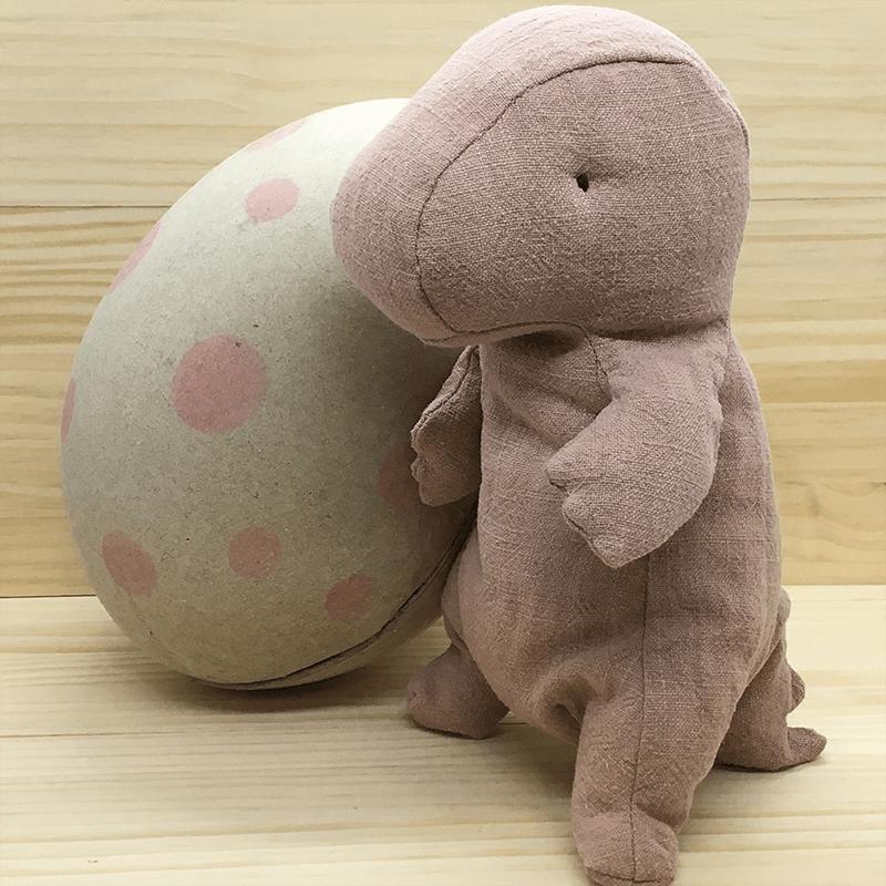 Muñeco Dino rosa con huevo